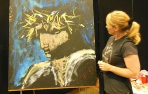 Stephanie Burke looks at one of her paintings of Christ