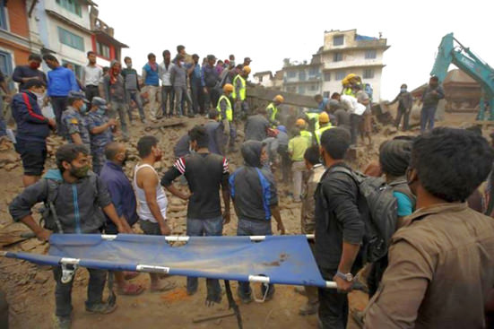 Image from REUTERS/Navesh Chitrakar, courtesy trust.org of workers in Nepal helping victims of the earhquake.